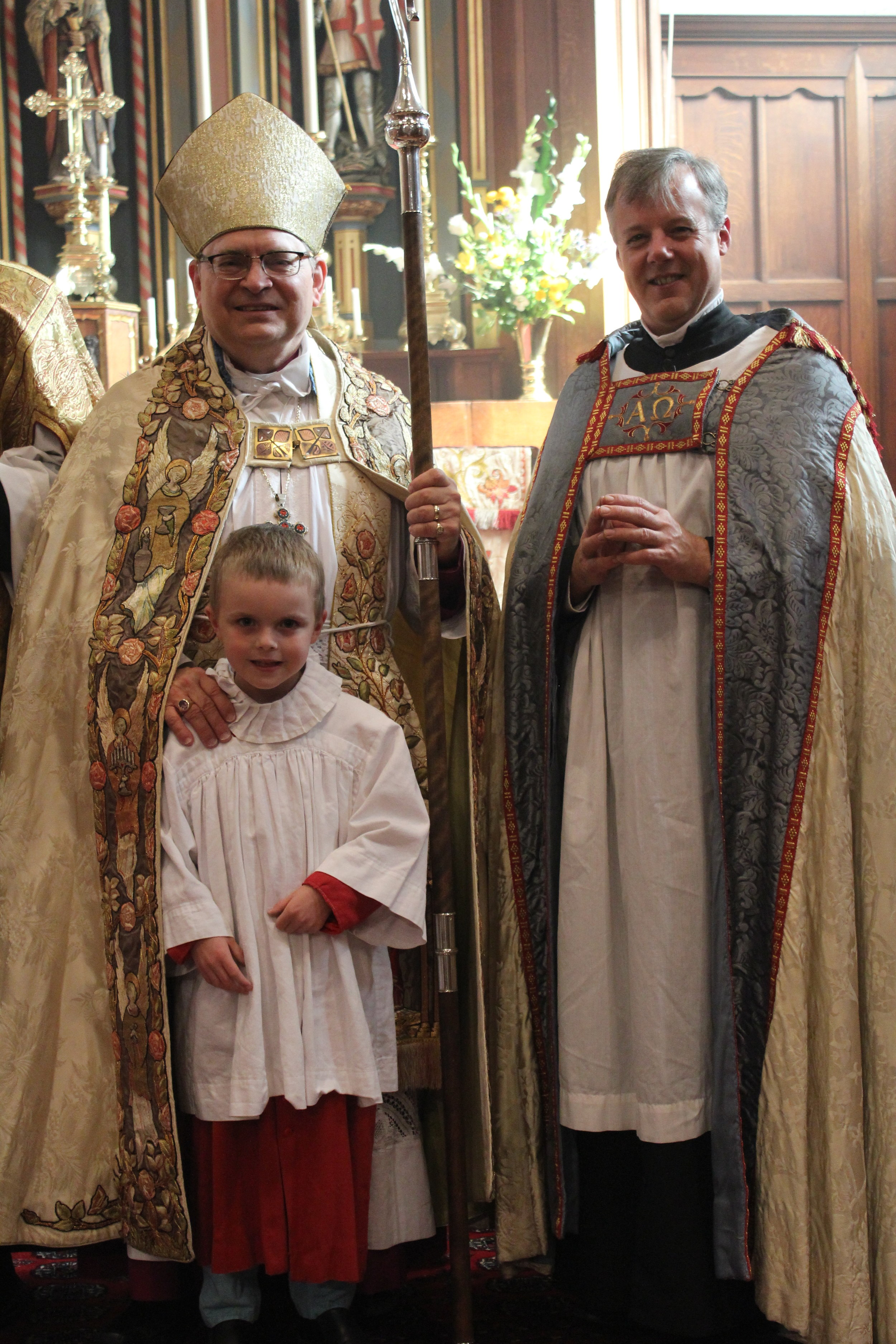 Archbishop Colin Johnson and Rev'd Mark Andrews with boat boy Kevin Coultes, Feast of Dedication 2018.