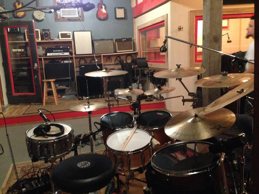 Drums: Mapex, Gretsch, Tama, DW Cymbals: Sabian Sticks: Vic Firth