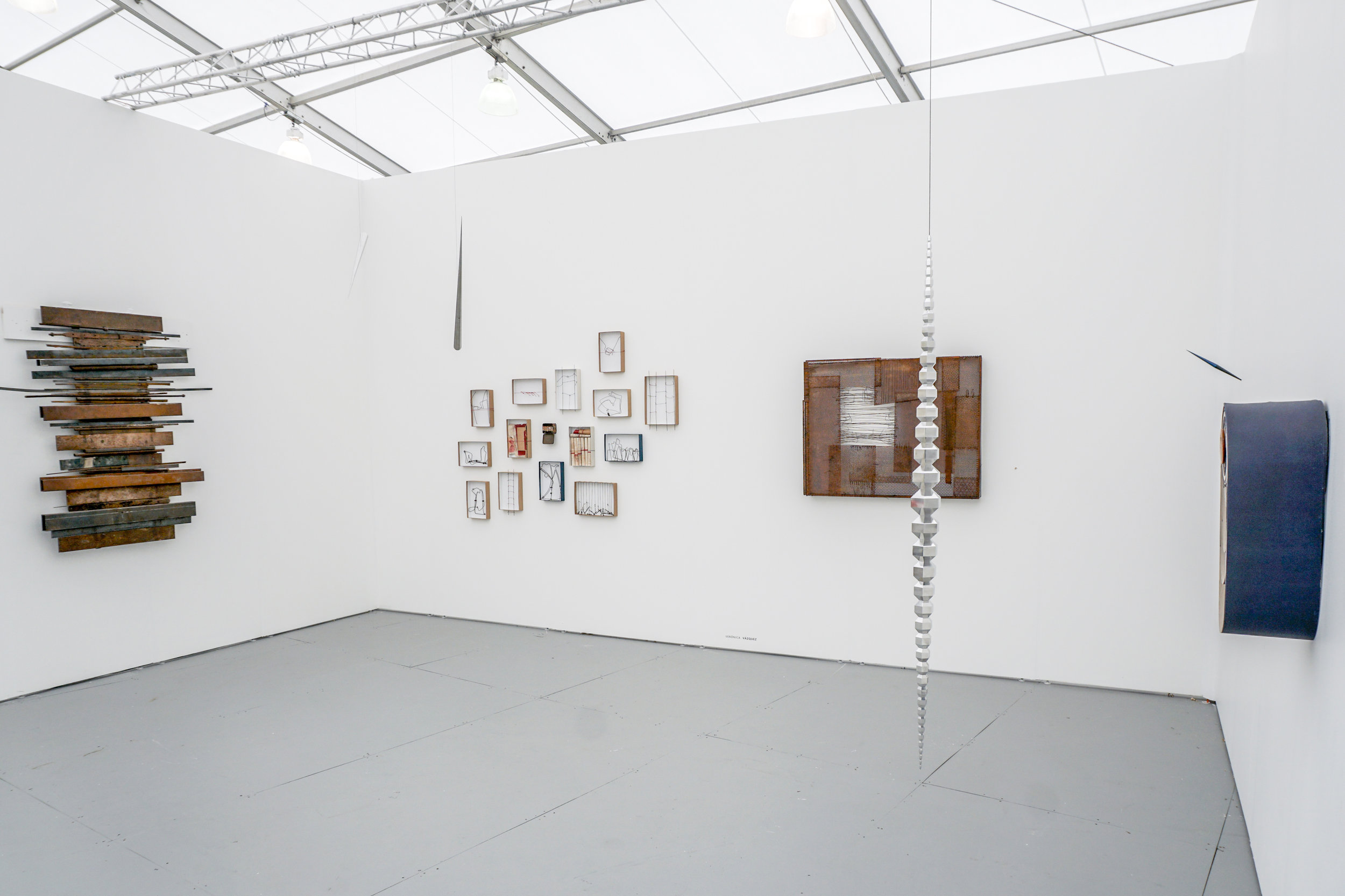 Works by Veronica Vazquez and Artur Lescher, installation view at Untitled Miami Fair. Photo courtesy of Piero Atchugarry Gallery.