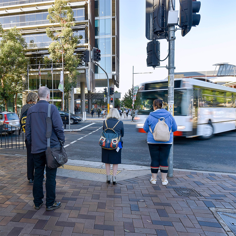 Pedestrians standing on a street corner