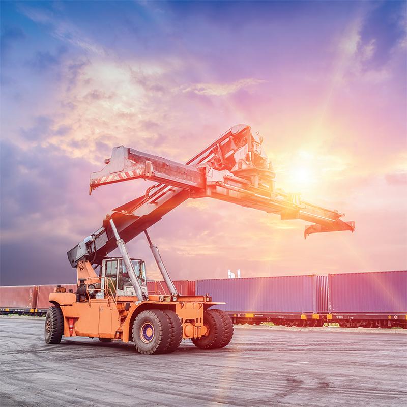 A crane truck at a rail freight yard