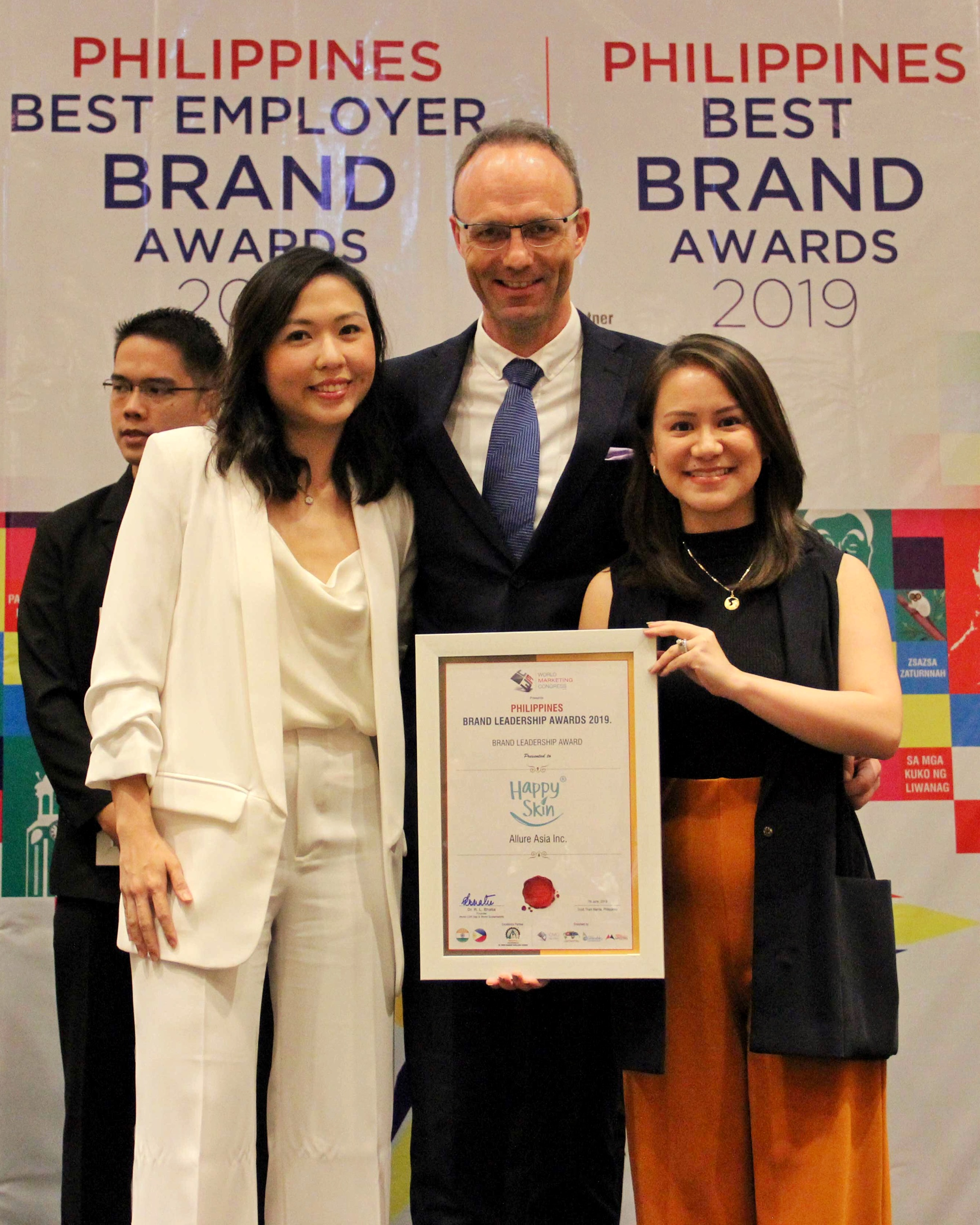 Adrian Stray Presenting Brand Leadership Award to Philippine National Bank