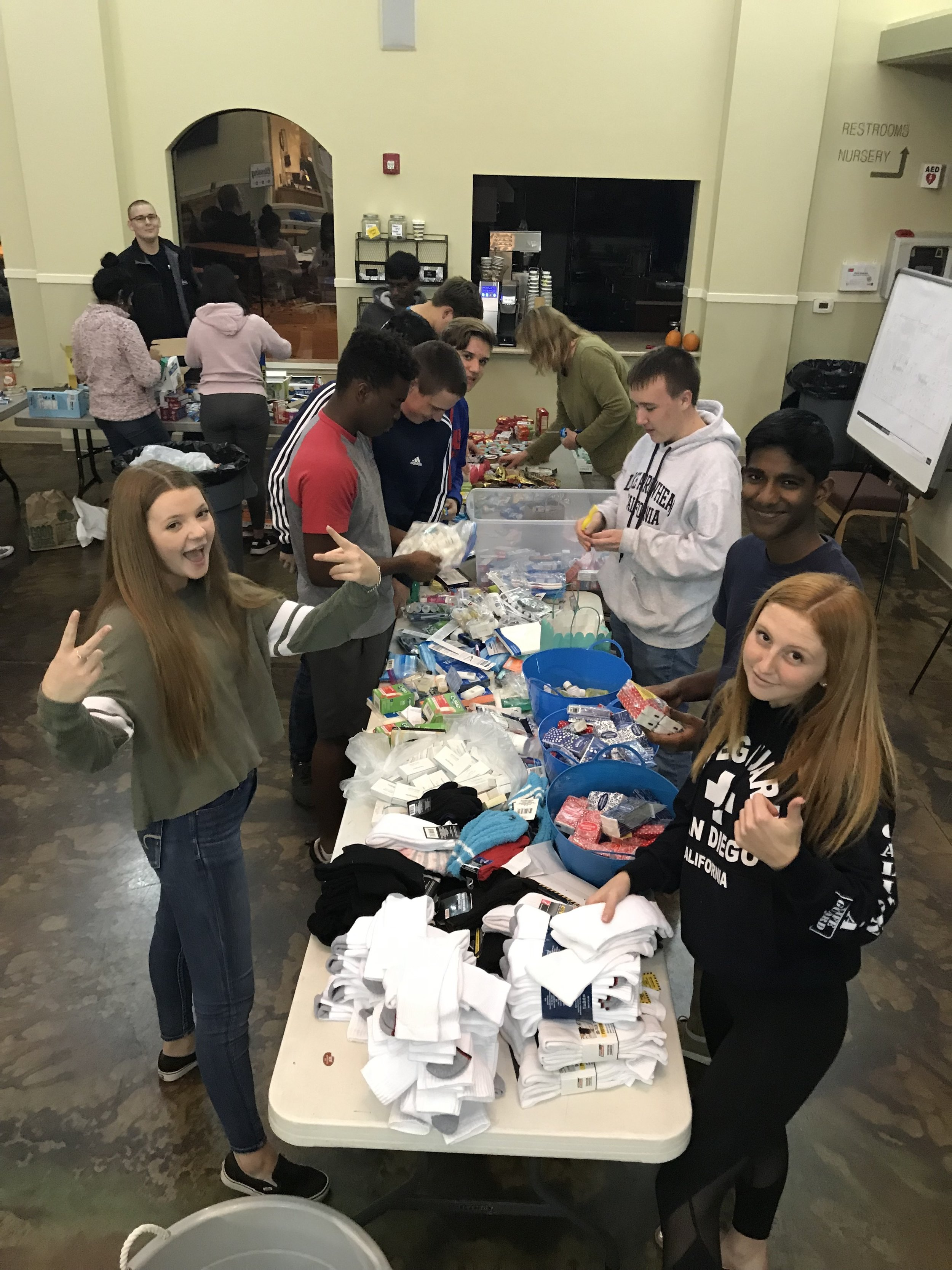 Holiday Care Packages - Assemble and distribute essentials to those in need in our community