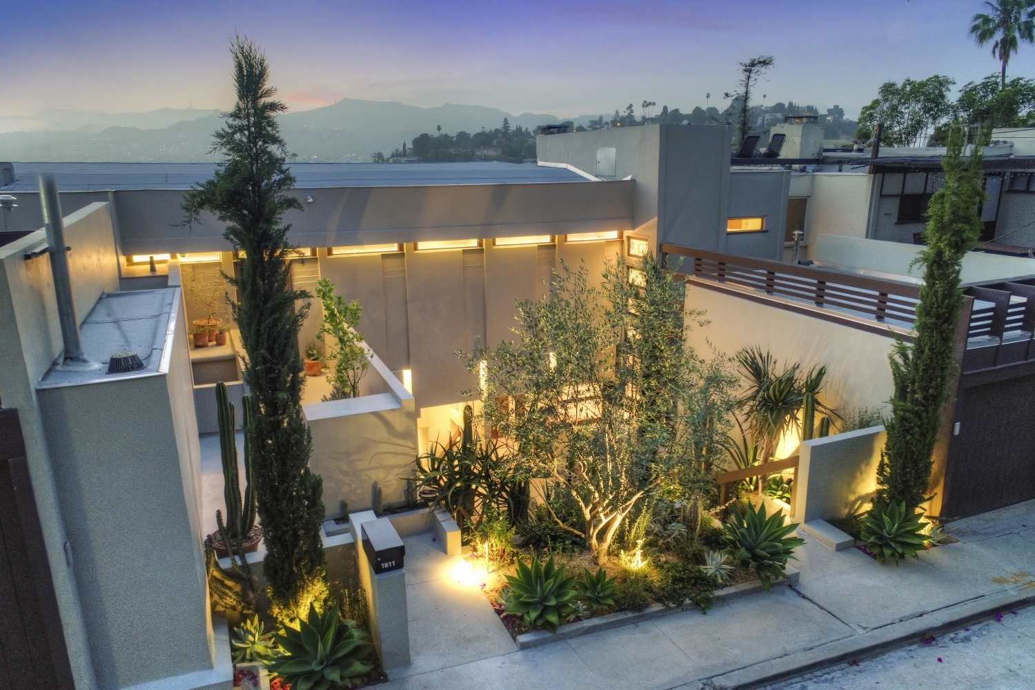 Overview of the Penthouse and adjacent cactus courtyard at Manola Court.