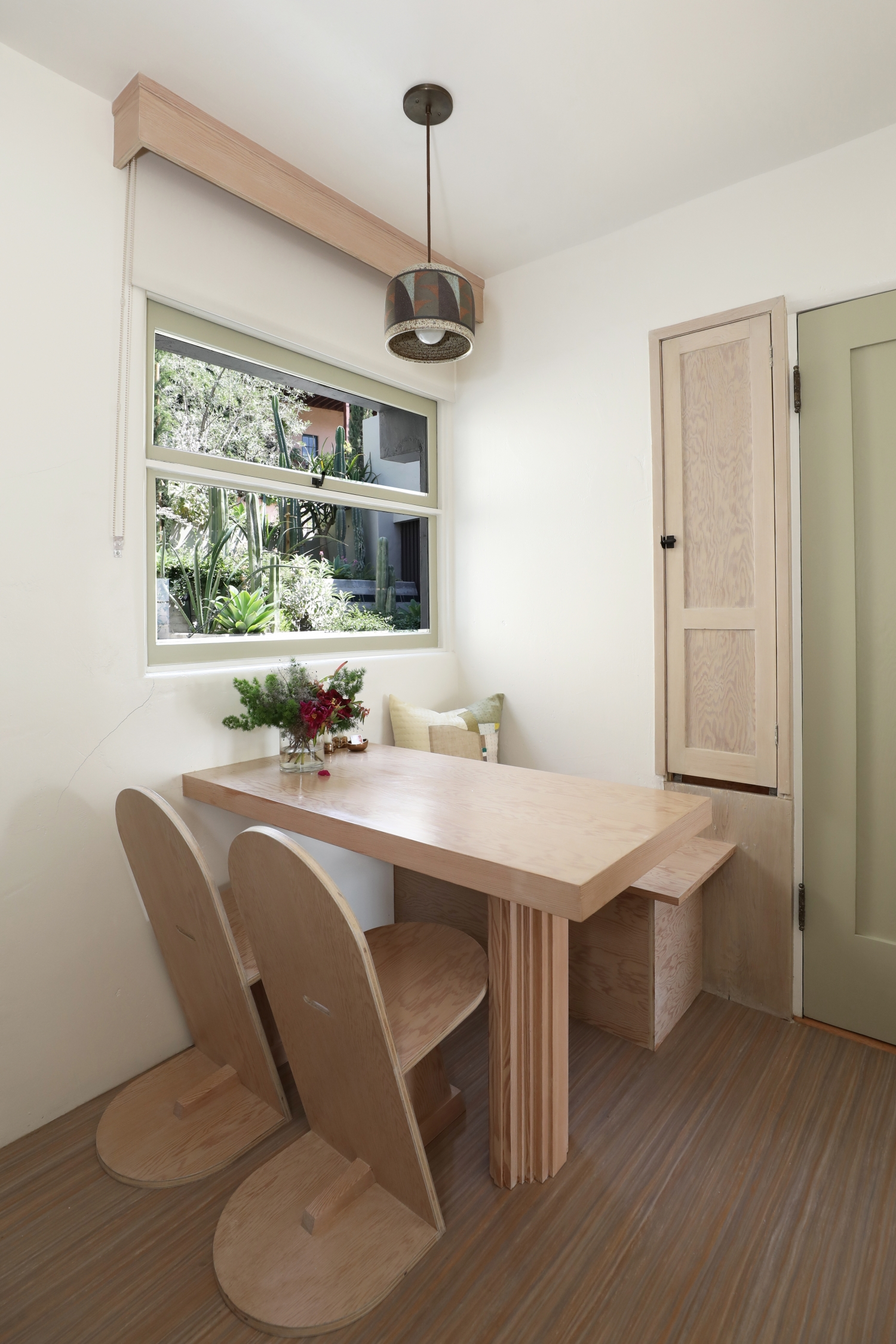 The dining nook in the Maid's Room at Manola Court, including replicas of Schindler designed table and chairs.