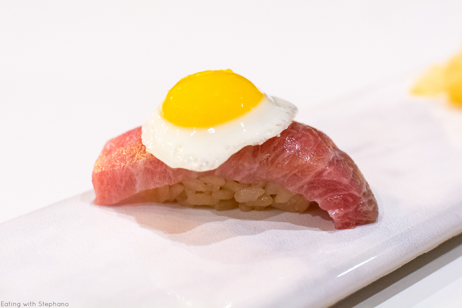 o-toro (extra fatty tuna) with fried quail egg