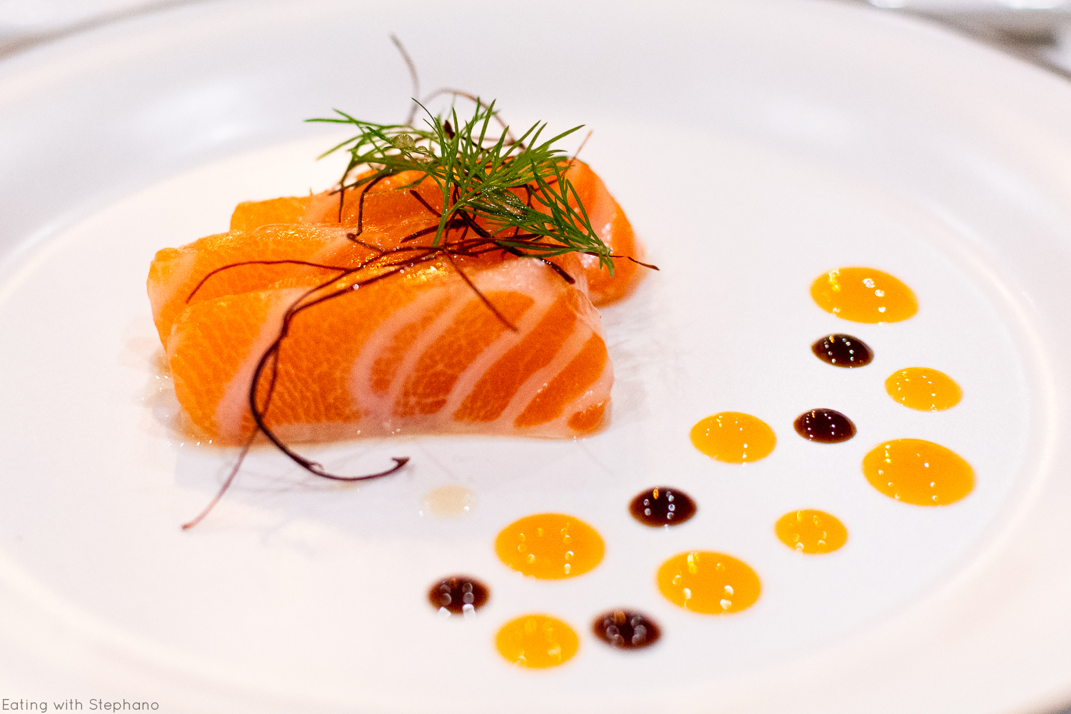 king salmon with frozen persimmon, persimmon gel, and tsume