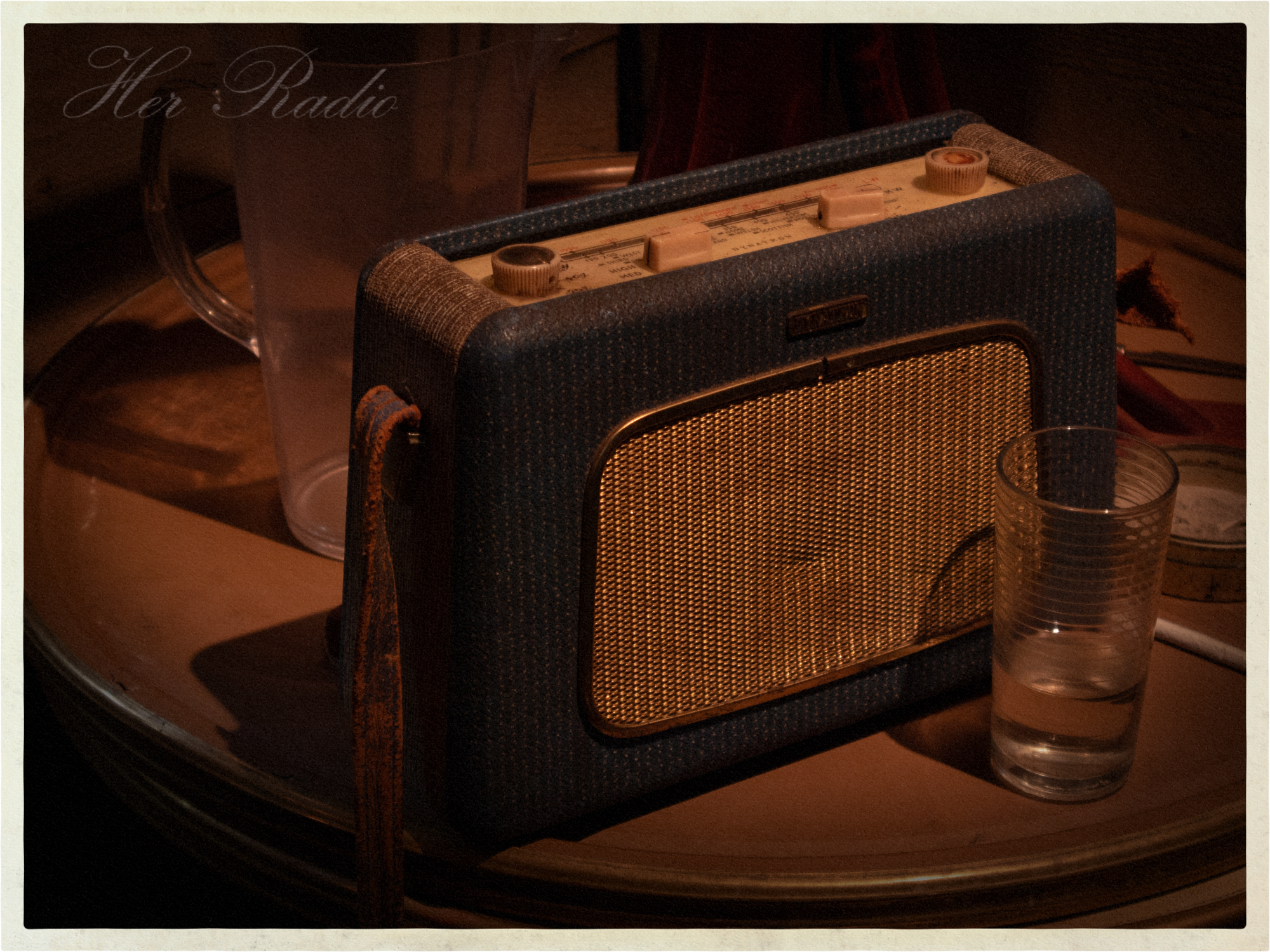 Her radio, swells.
