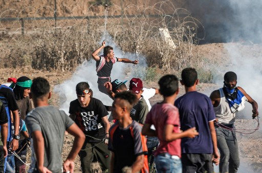 A Palestinian rioter uses a slingshot to hurl a stone at Israeli forces during clashes along the border w east of Bureij in the central Gaza Strip on September 6. (Mahmud Hams ,AFP)