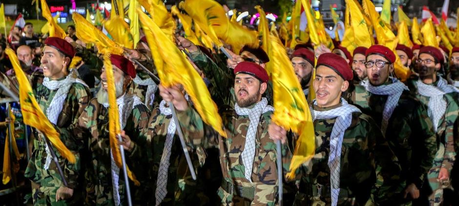 Hezbollah supporters listen to leader Hassan Nasrallah deliver a speech in May during a gathering to commemorate the Al-Quds (Jerusalem) International Day in Beirut. (Credit: Nabil Mounzer, EPA-EFE, Shutterstock).