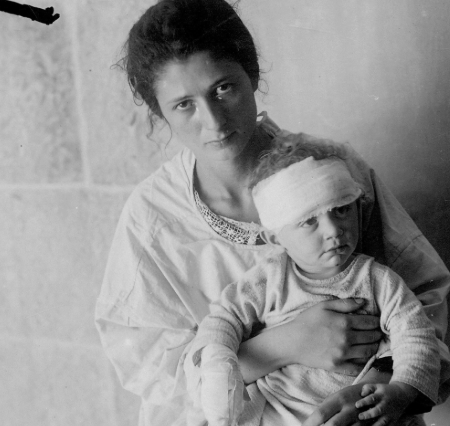 A Jewish mother holds her injured child after the Hebron Massacre of August 23-26, 1929. (Credit: Unknown)