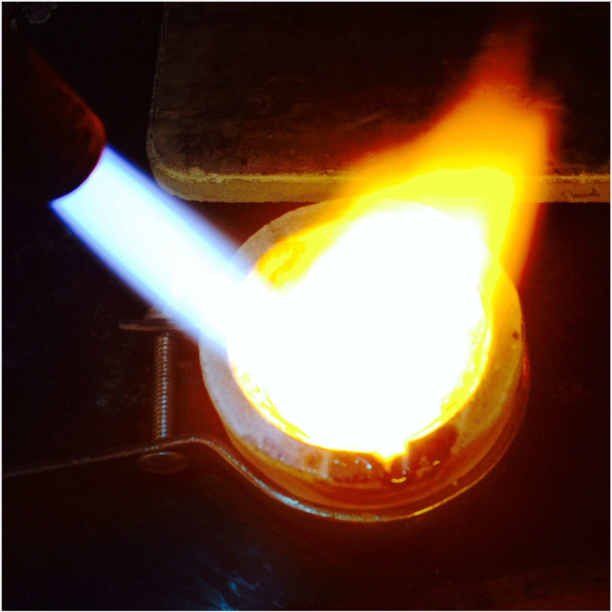 melting metal in the crucible