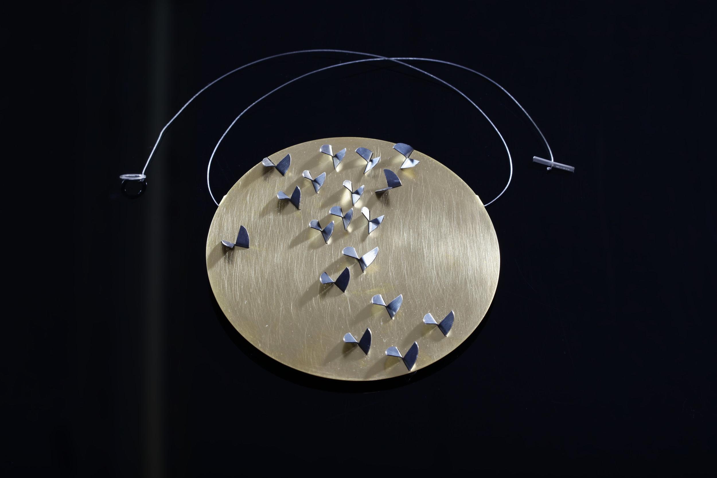 Migration Necklace 10x10.jpg