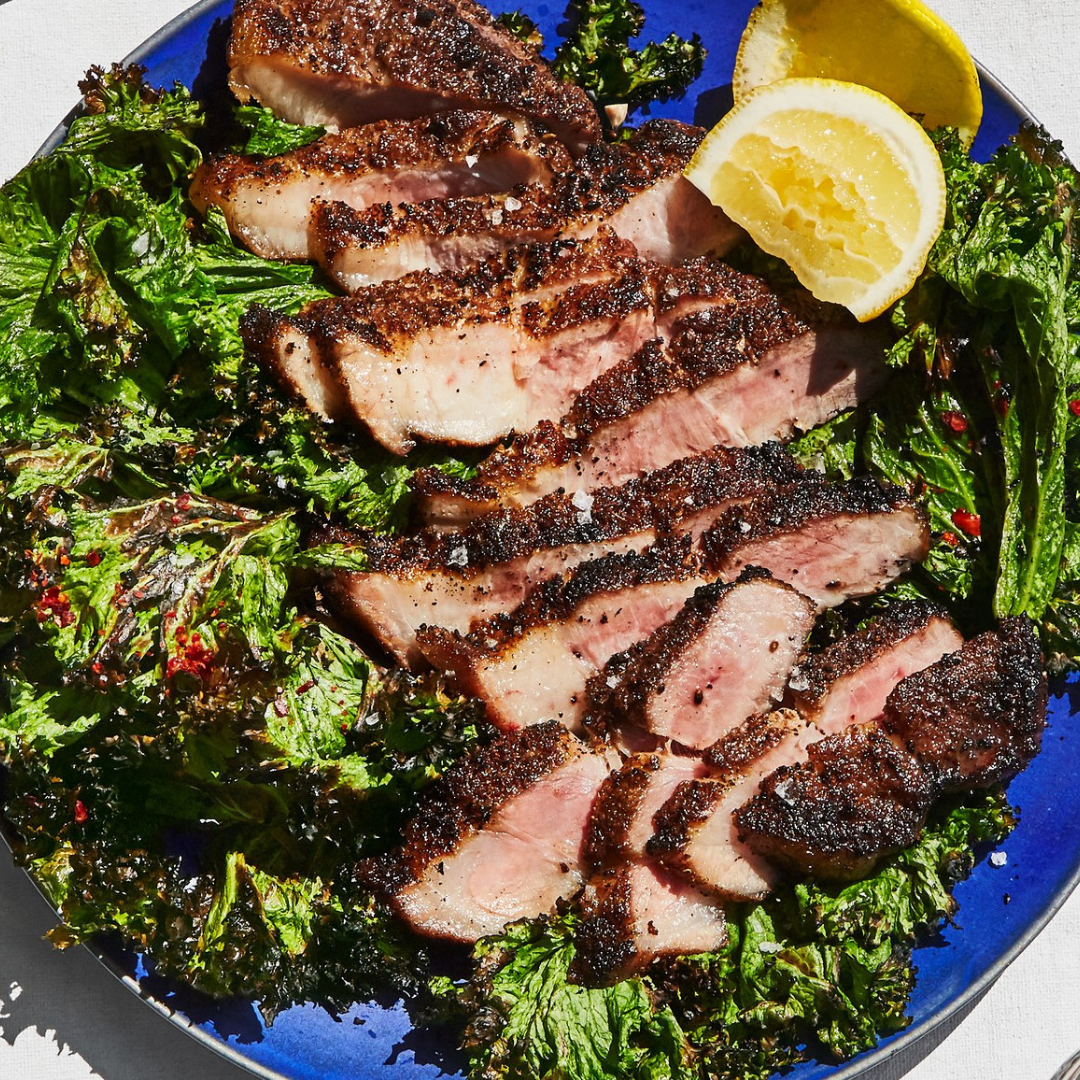 Pork Shoulder Steaks with Grilled Mustard Greens - If you want to impress at your next backyard barbecue party, spark up the grill and give this recipe a go! This grilled pork shoulder is moist, and the spices will send your taste buds soaring. Not to mention the final presentation is positively stunning. It's so good that you might not want to share!Get the recipe>>