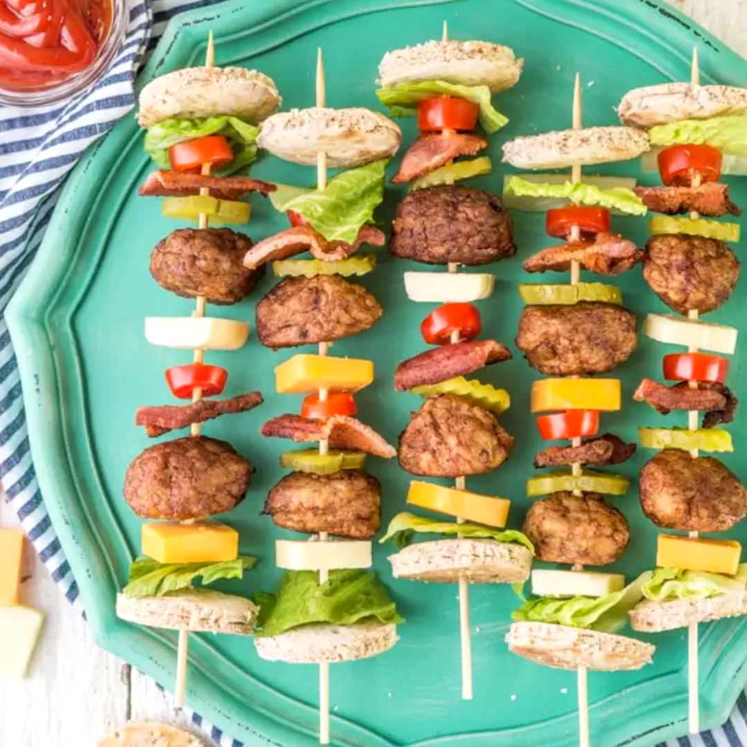 Deconstructed Bacon Cheeseburger Kebabs - If you're in the mood for burgers, then this is the perfect recipe to make for your next picnic. Skewer meatballs and your favourite burger toppings inside two pieces of bread. This recipe is simple and delicious for a warm afternoon at the park.Get the recipe>>