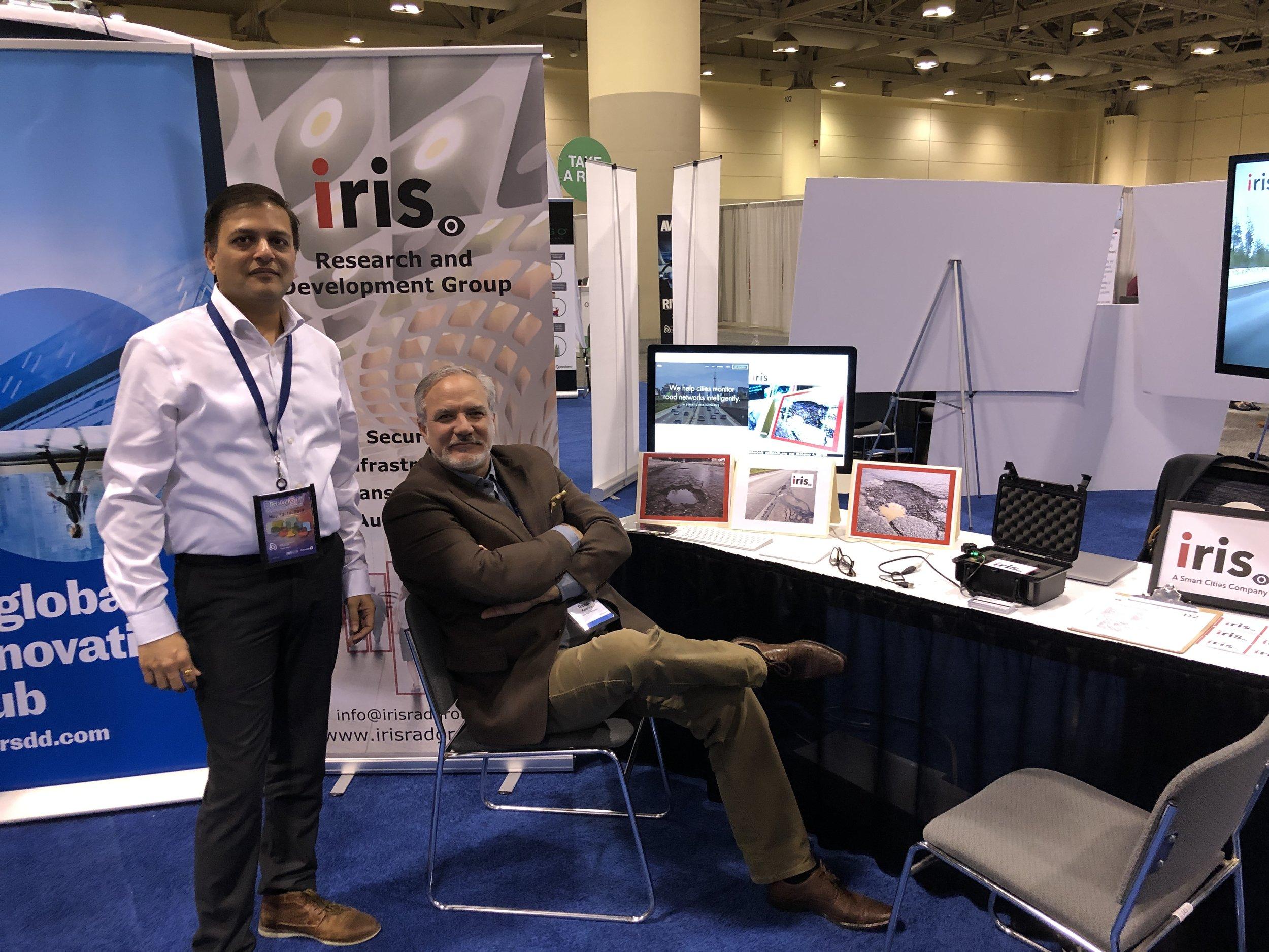 David Keaney CFO, and Saurabh Mahajan COO at the IRIS booth next to MaRS Toronto RTDS Booth.