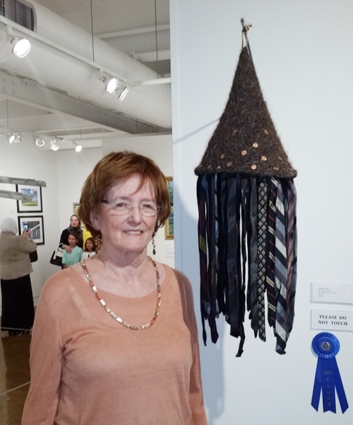 Barbara Cade with  Hair Hat #4  won 1st place and a solo exhibit at the Fort Smith Regional Art Museum.