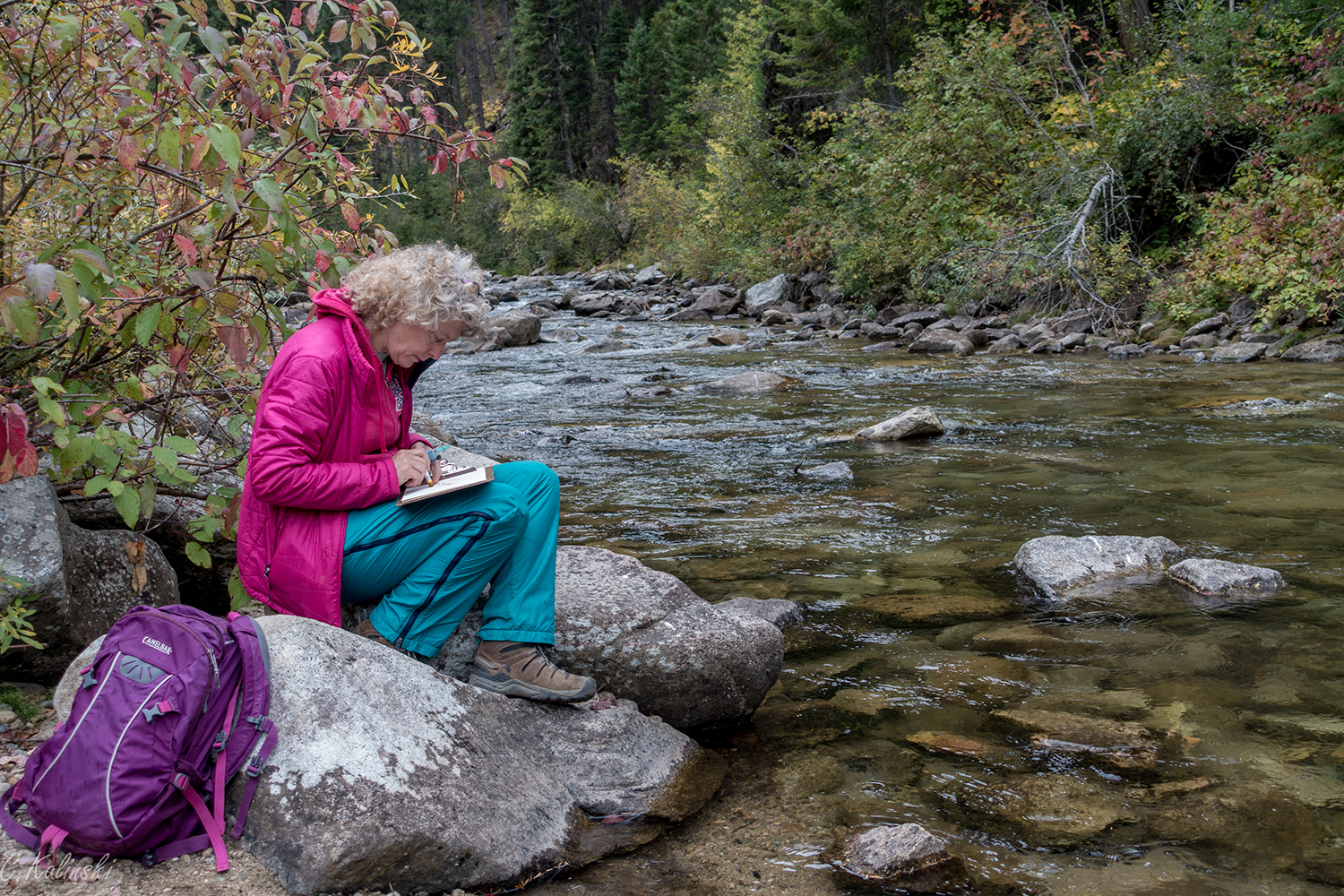 Painting on the river at the ranger station, Magruder Road, Montana. Photo by Cass Kalinski, 2016.
