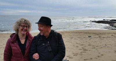 Annette-Cass-on-beach-laughing-400x212.jpg