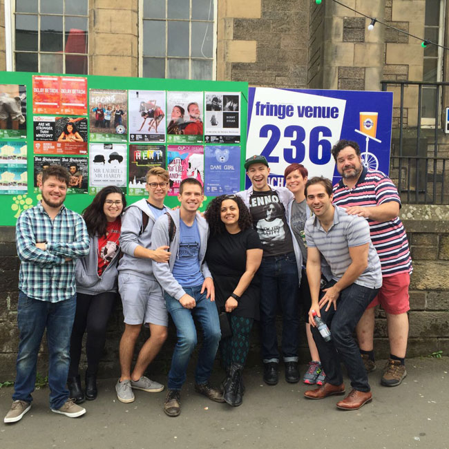 The Dani Girl Fringe Team outside Greenside Infirmary Square with our poster alongside the rest of the Greenside shows.