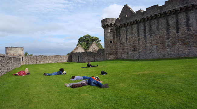 The Dani Girl Team napping outside of Craigmillar Castle.