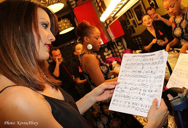 Caroline Bowman reviews her music before delivering a gorgeous opening number.