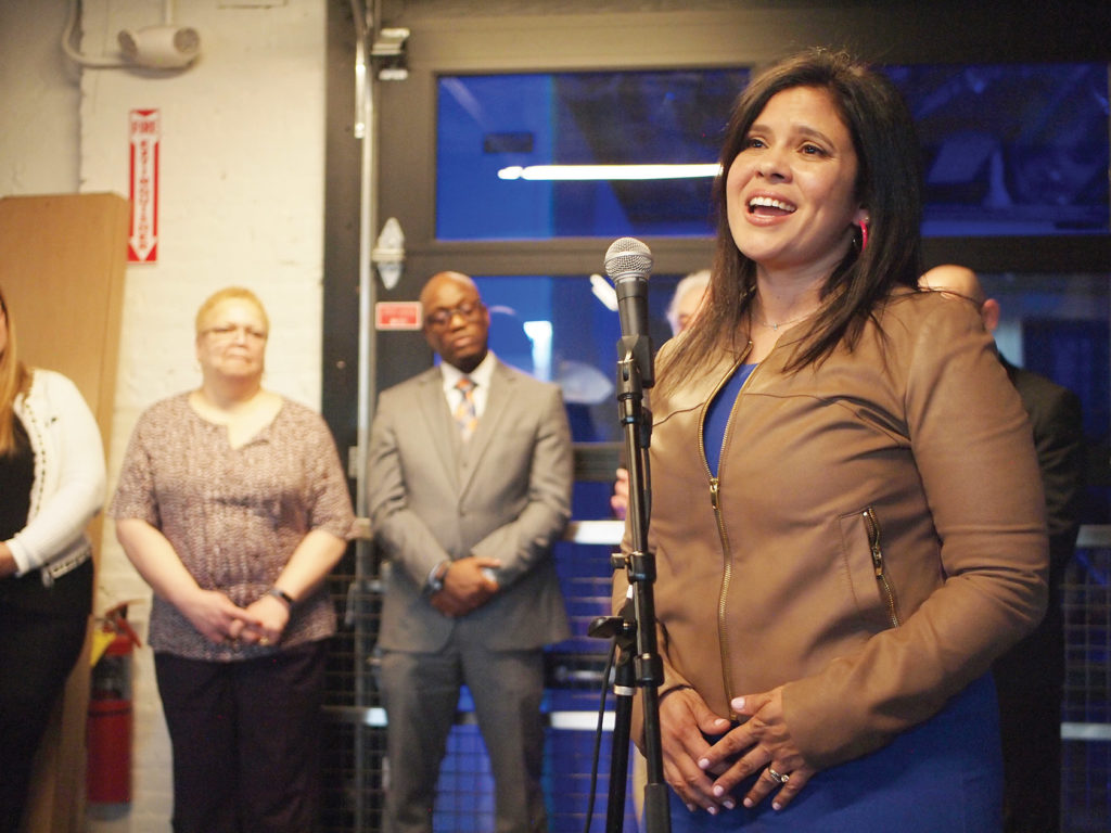 Credit to Bay State Banner:  Former director of the of the Mayor's Office for Immigrant Advancement Alejandra St. Guillen speaks during her campaign kickoff at the Backlash Beer Company in Roxbury.