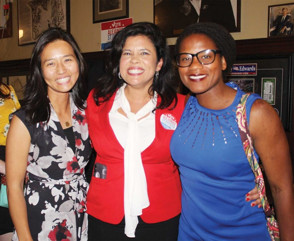 Alejandra St. Guillen savors a 4th-place finish during her campaign part at Doyle's in Jamaica Plan, joined by at-large Councilor Michelle Wu and District 1 Councilor Lydia Edwards.  PHOTO: ALEXA GAGOSZ