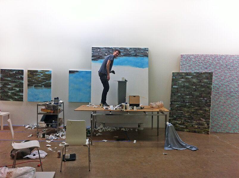Former artist-in-residence Neil Raitt painting in his GMF studio.
