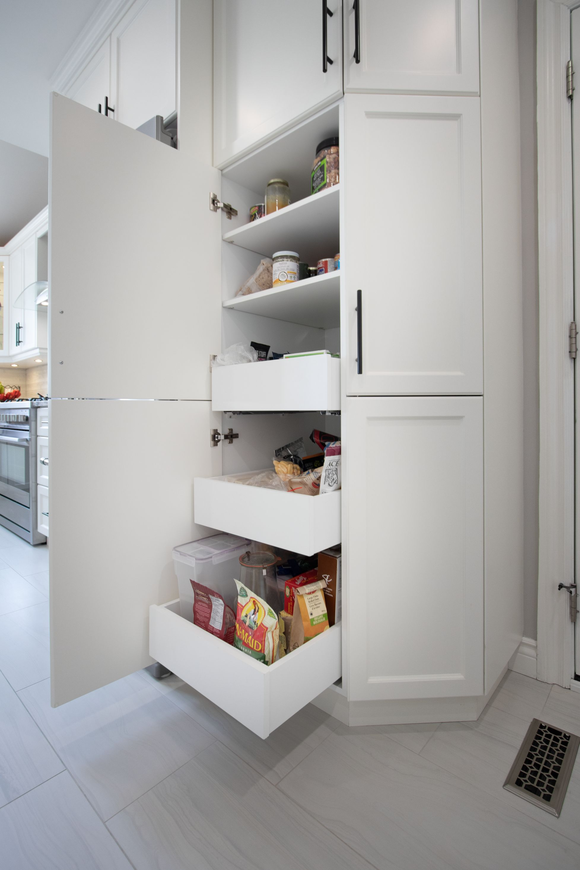 Gorgeous pantry with pull outs we designed and built for our client's custom kitchen renovation in Oshawa.