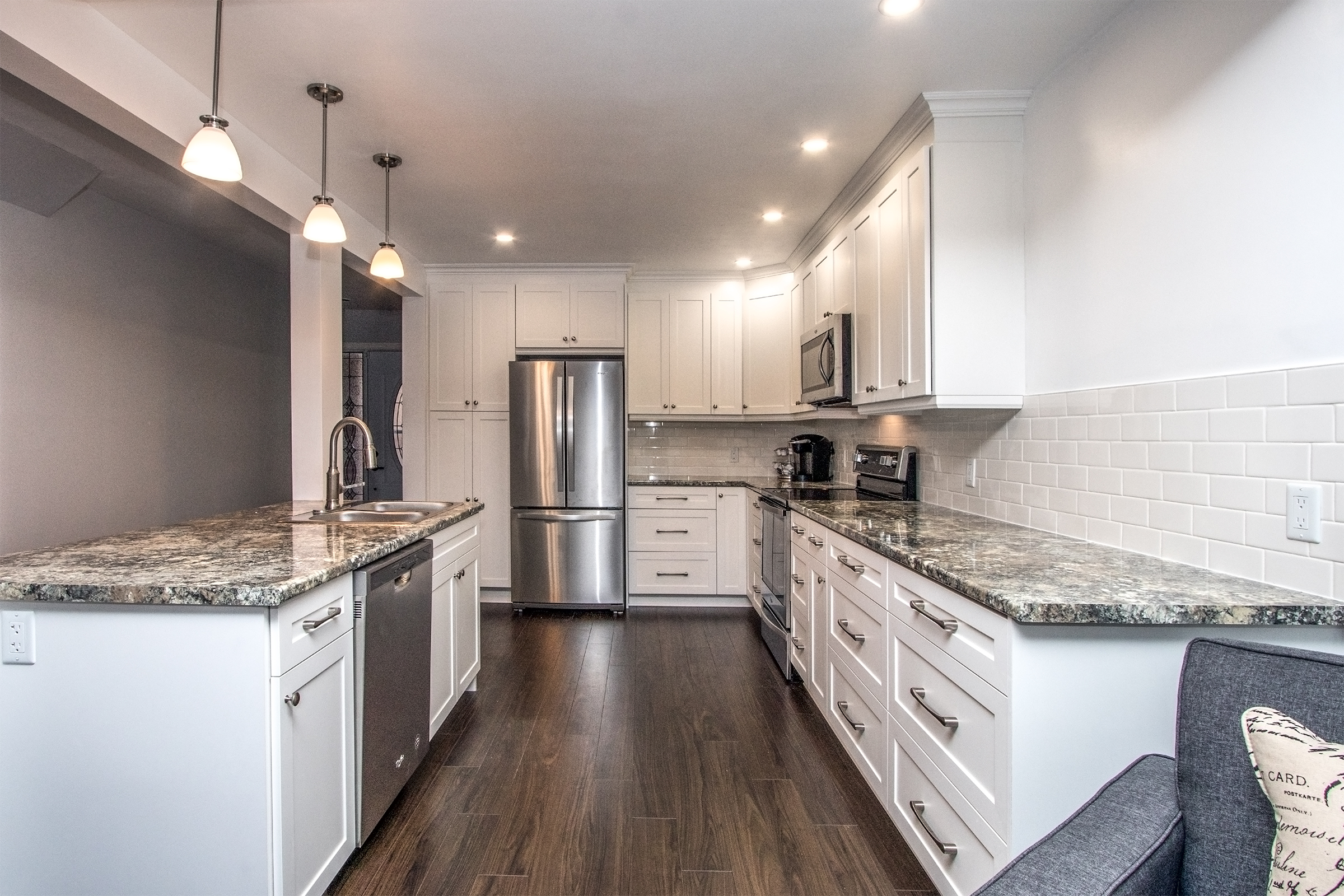 Tons of counter space here! Beautiful white shaker style cabinets with a laminate countertop. Laminate countertops have improved so much that they now have the look and feel of real stone.
