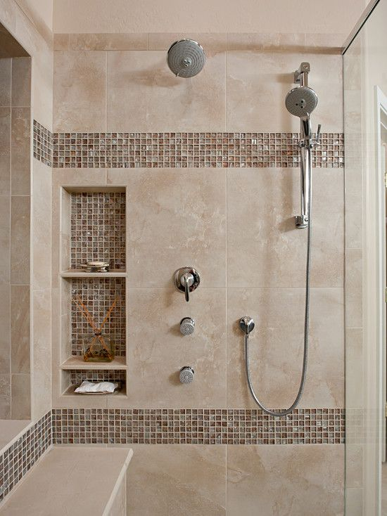 Expertly tiled shower niches using the accent tile create symmetry throughout the shower.