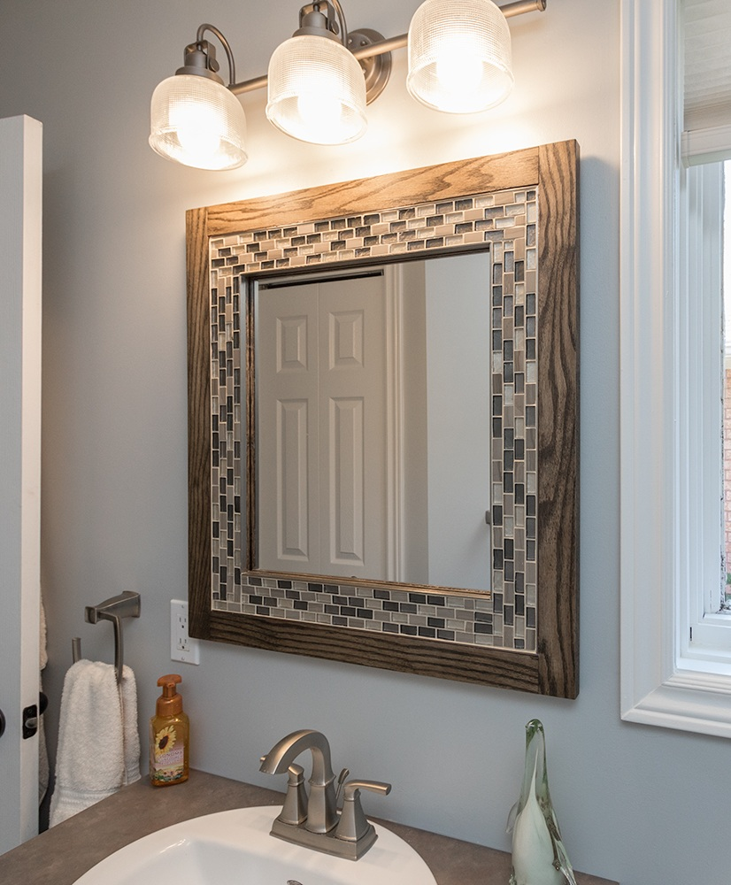 This custom made mirror by our carpenter Bill was made using the accent tile from the shower.