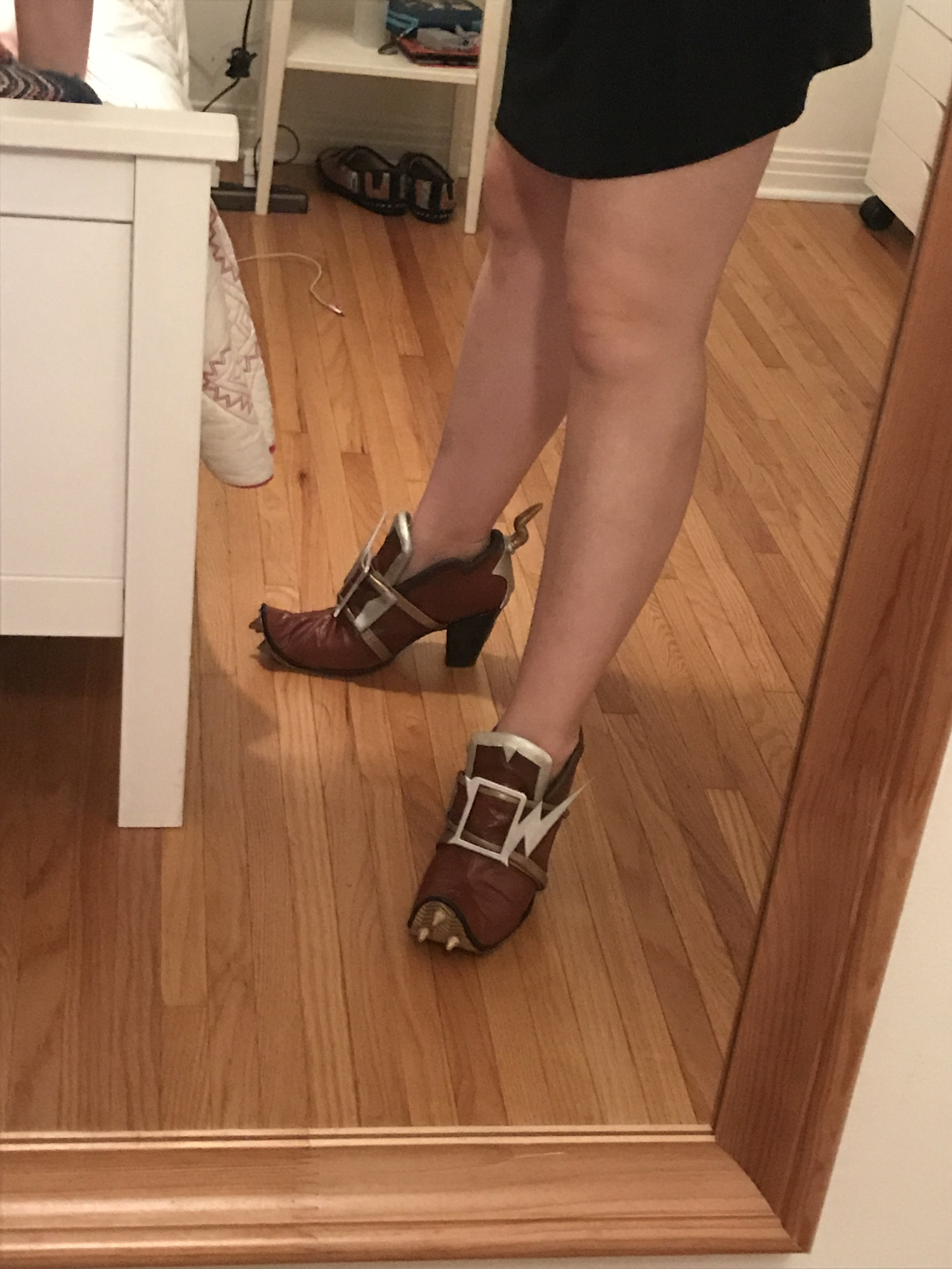 I bought boots and cut them up for this, before covering them with foam and fabric (the spikes and back part are black worbla). My feet are a little big for my height, so I didn't want to just add extra length to the front of the shoe, instead cutting off the toe and making a new toe with heat-shaped foam.