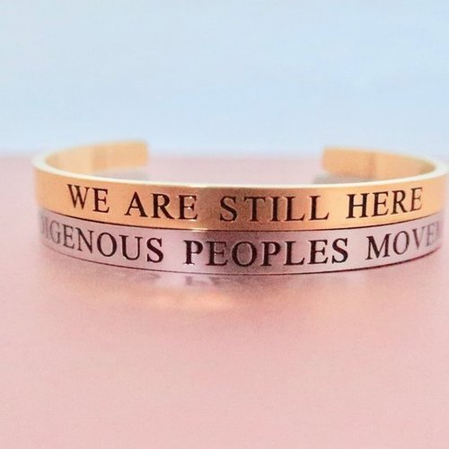 "From Indigenous Intentions.  "" We are still here "" &  "" Indigenous Peoples Movement ""  Sold separately or together. Part of the Proceeds go to The Indigenous Peoples Movement."