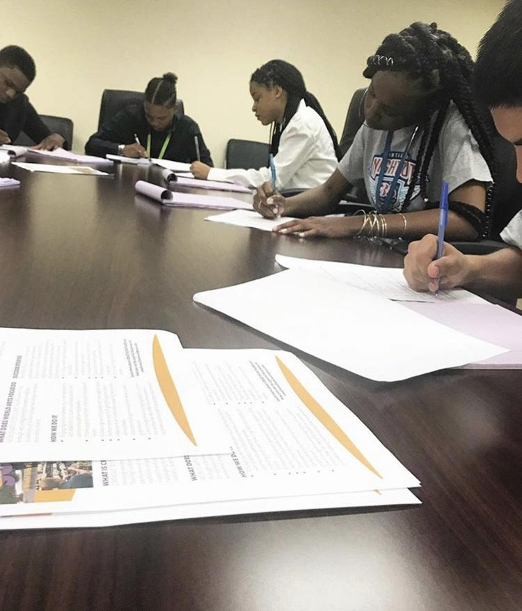 National Night Out TNI Interns entering Creative Suitland survey responses, Country Administration Building, 8/1/18