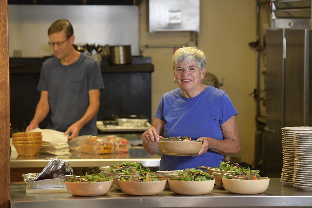 Volunteers prepare a meal at Luke House. (Photo by Alyson Pilch of Pilch and Barnet)