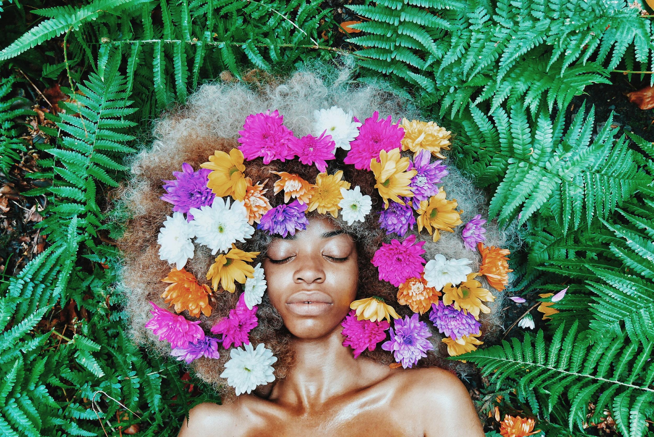 Canva - Woman With Floral Headdress Lying on Green Leaf Plants.jpg