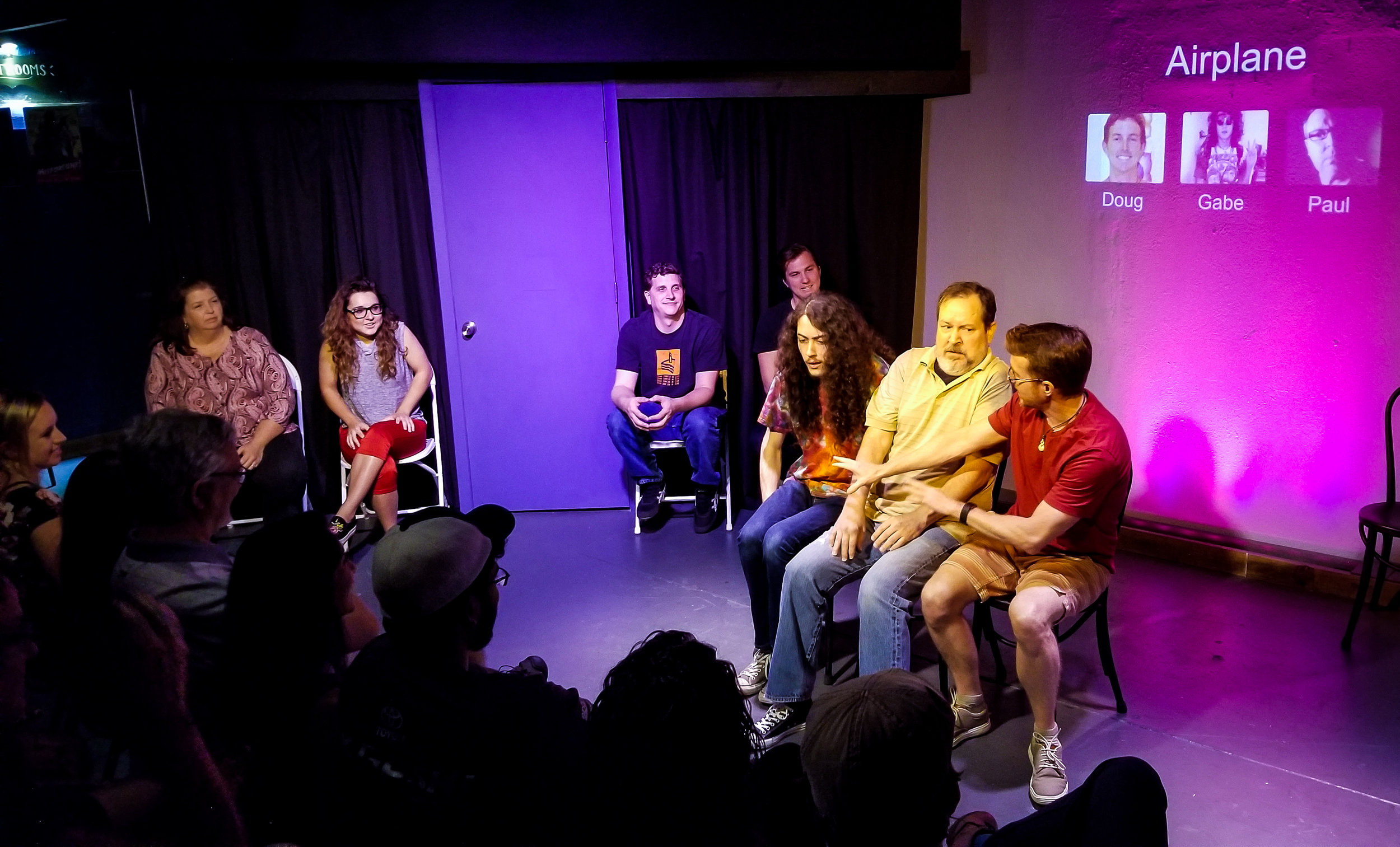 Doug playing Airplane with Gabe and Paul in Whose Line St Pete.