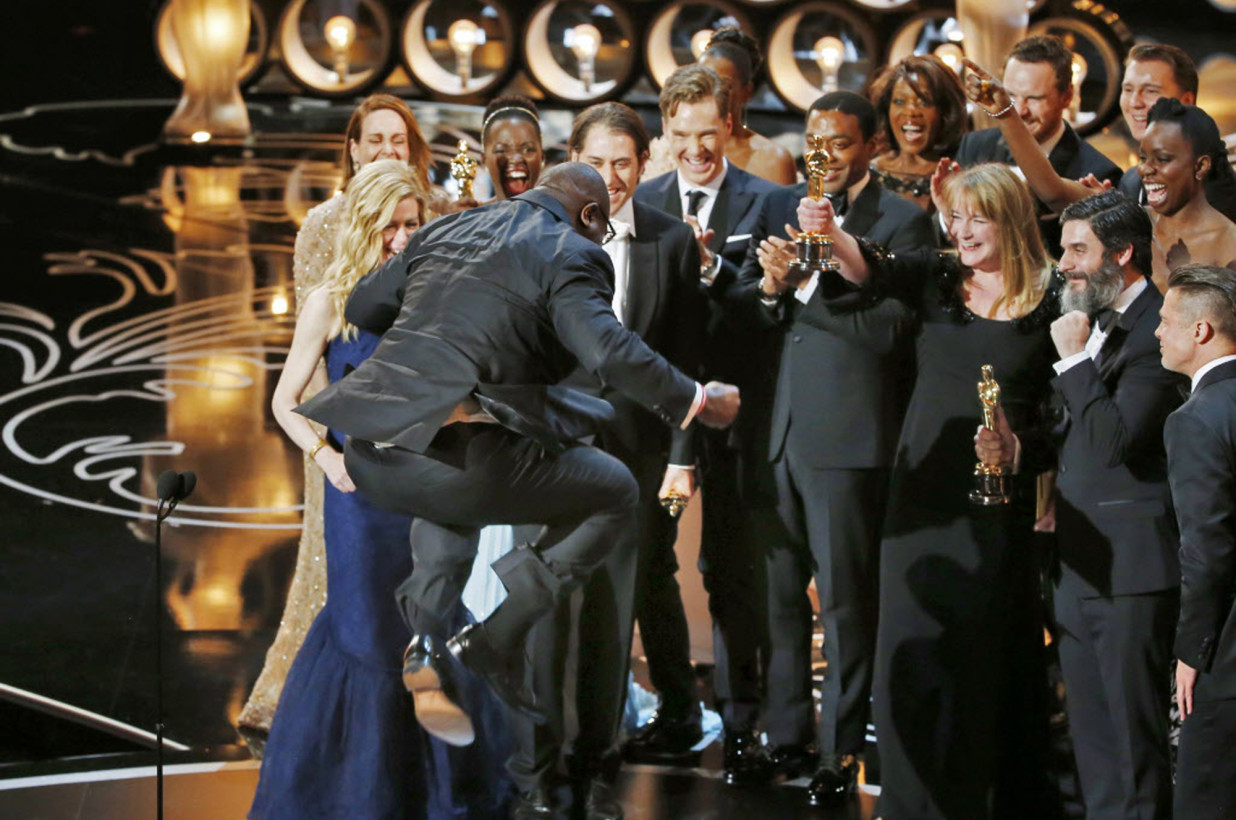 """Photo Credit: Reuters - Steve McQueen jumps with joy after accepting the Oscar for Best Picture for his work on """"12 Years a Slave"""""""