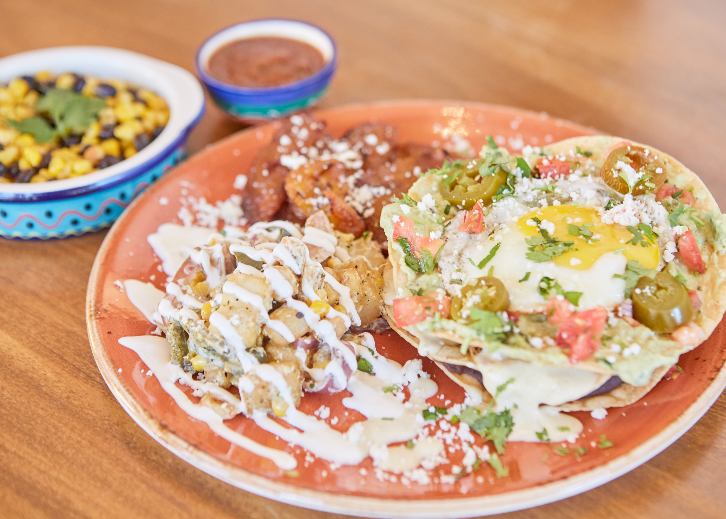 WEEKEND BRUNCH $9.99 - SERVED ON WEEKENDS 'TIL 3PMMIGAS Tortilla strips scrambled with two eggs, chorizo, pico de gallo, Oaxaca cheese, and topped with cilantro and cotija cheese; served with black beans, Yucatan potatoes and two flour tortillasOCHO STACK Three crispy corn tortillas stuffed with black beans, asadero cheese, carnitas, and topped with an egg, avocado crema; served with Yucatan potatoes and plantainsHUEVOS RANCHEROS Two corn tortillas topped with black beans, fried eggs, tomatillo salsa, queso fresco; served with Yucatan potatoes and plantainsBUENOS DIAS Breakfast potatoes and brisket cooked in a Argentinian sauce and topped with a fried egg, cilantro, and Mexican crema; served with flour tortillas