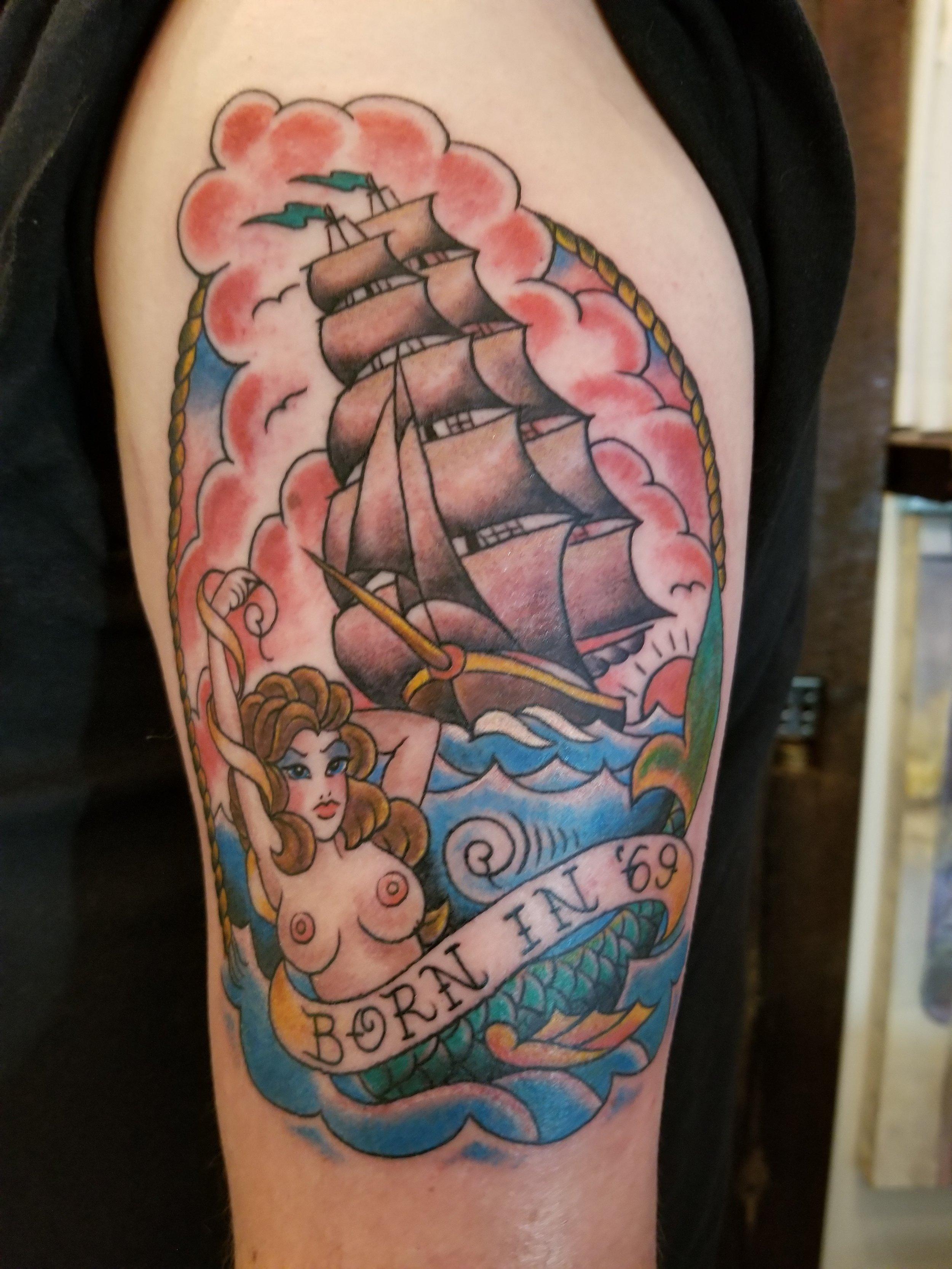 Ship and mermaid