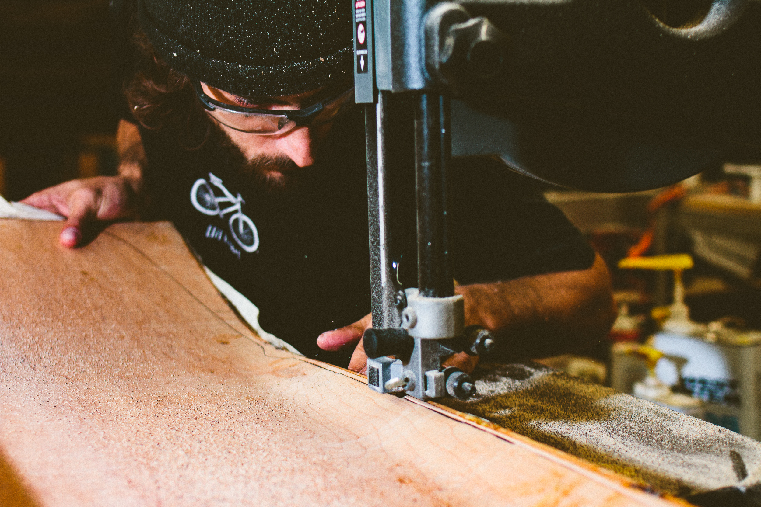 Gibson cutting out a freshly pressed board on the band saw.