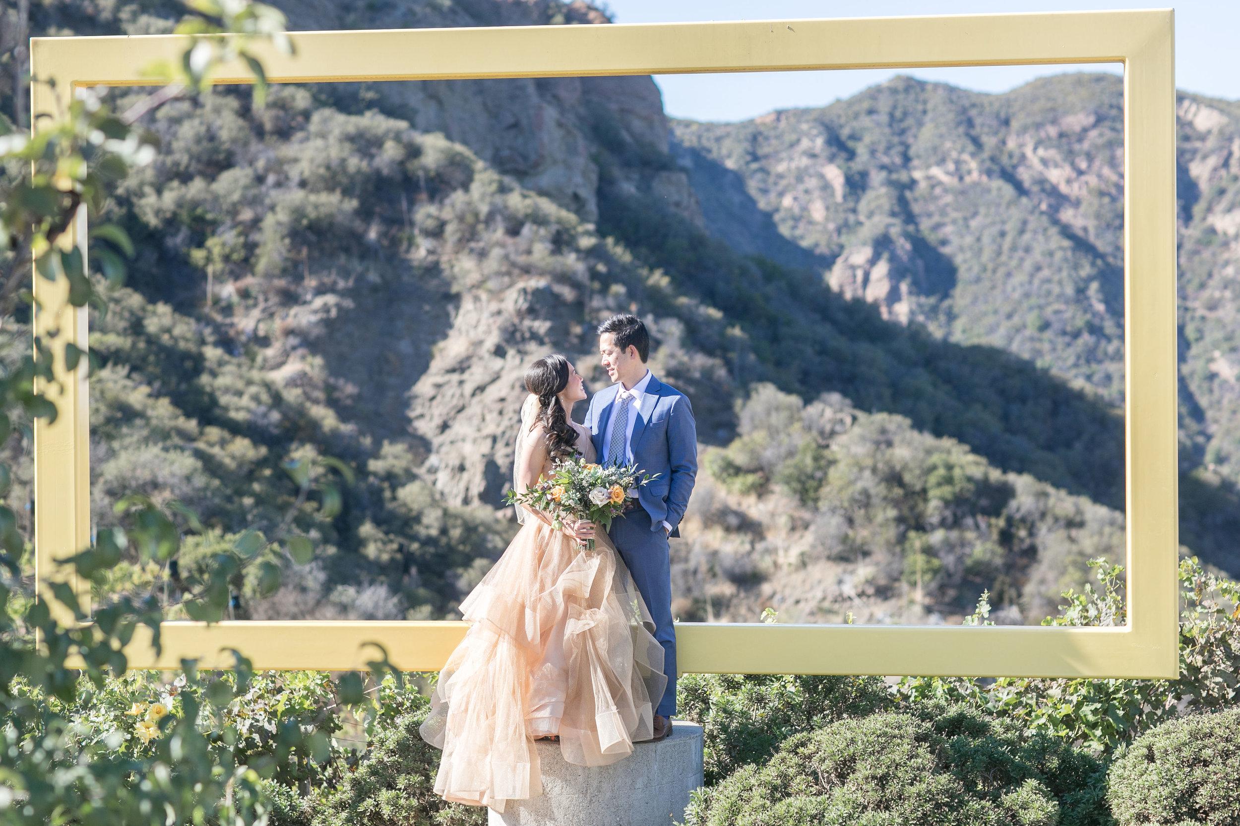 Melanie+Seiji-saddlerockranch-malibucaliforniawedding-couplesportraitsandweddingparty-0215.jpg