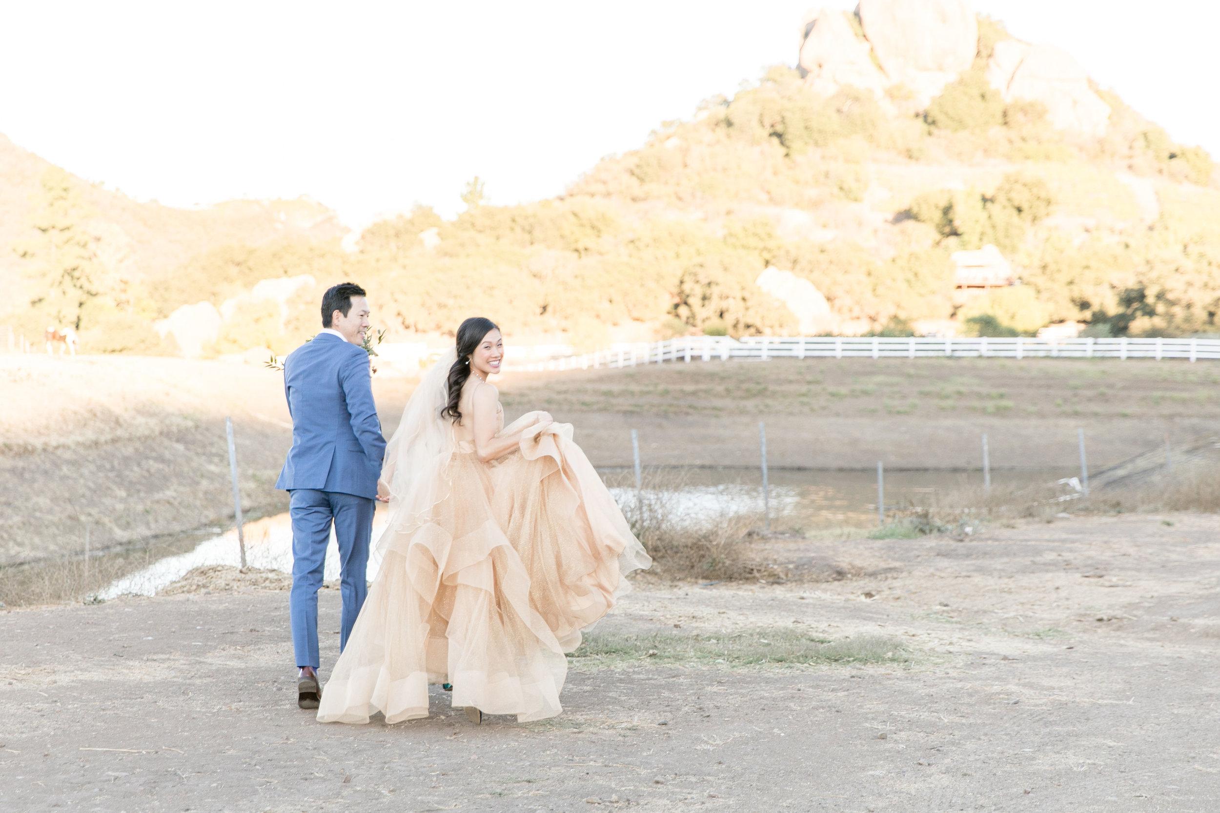 Melanie+Seiji-saddlerockranch-malibucaliforniawedding-couplesportraitsandweddingparty-0269.jpg