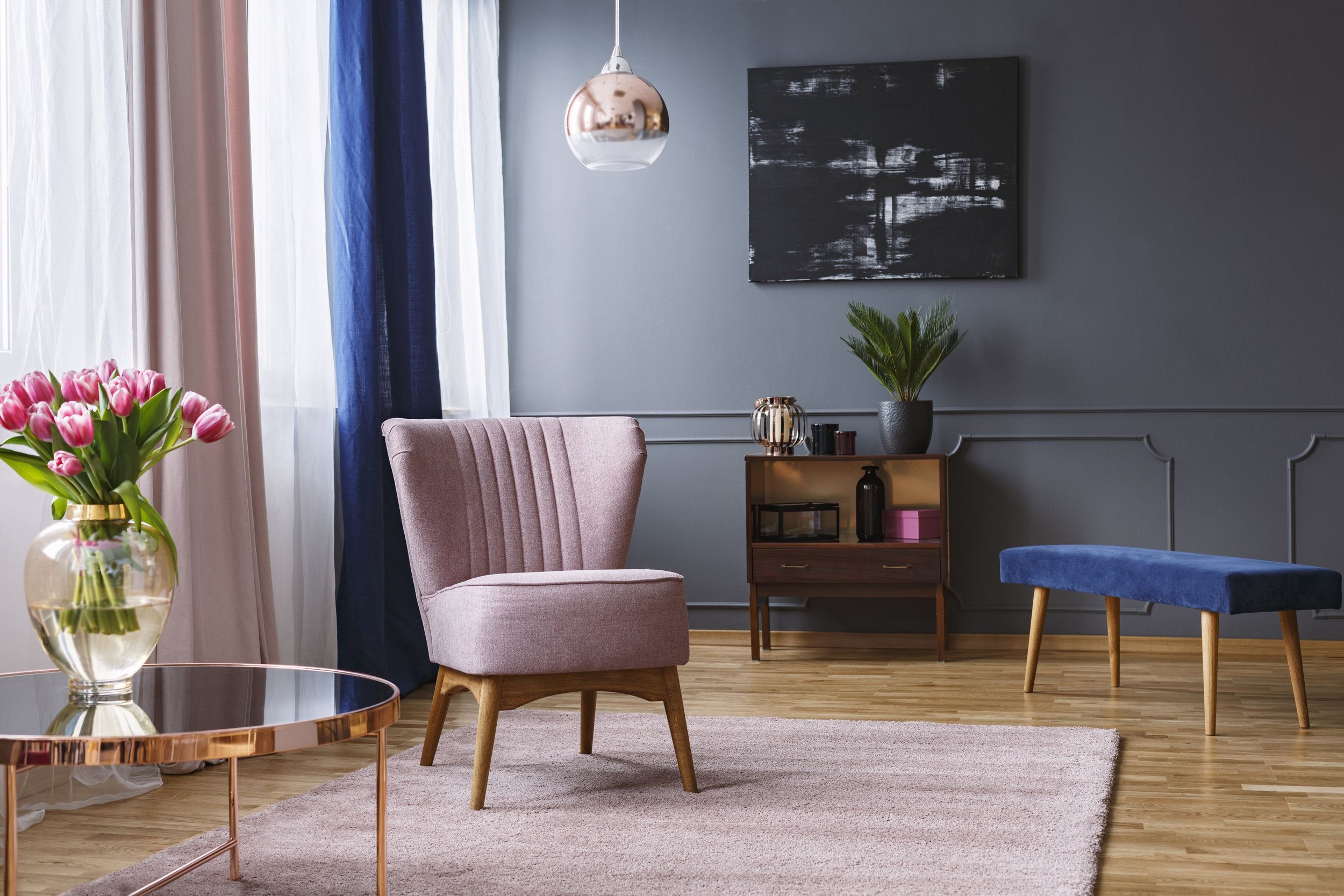 pink chair, blue interior