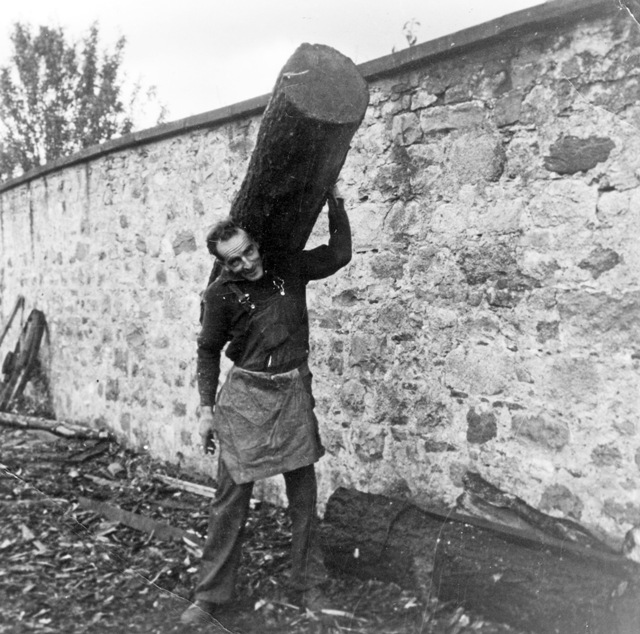 Carrying timber for a railway sleeper, 1968