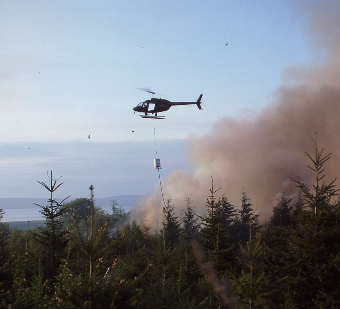 Helicopter bucket in action, Culloden, 1984