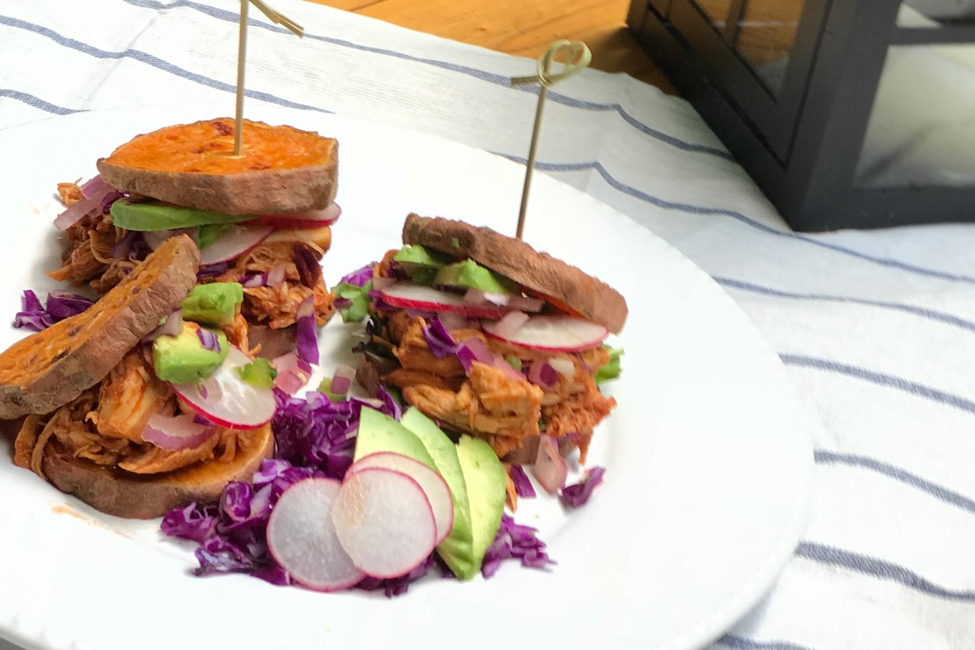 Buffalo Sliders featuring The New Primal's medium buffalo sauce! Great flavor, good heat. It pairs great with the sweet potato sliders and crunchy red cabbage and radishes. Cool it off with a little avocado and a squeeze of lime!
