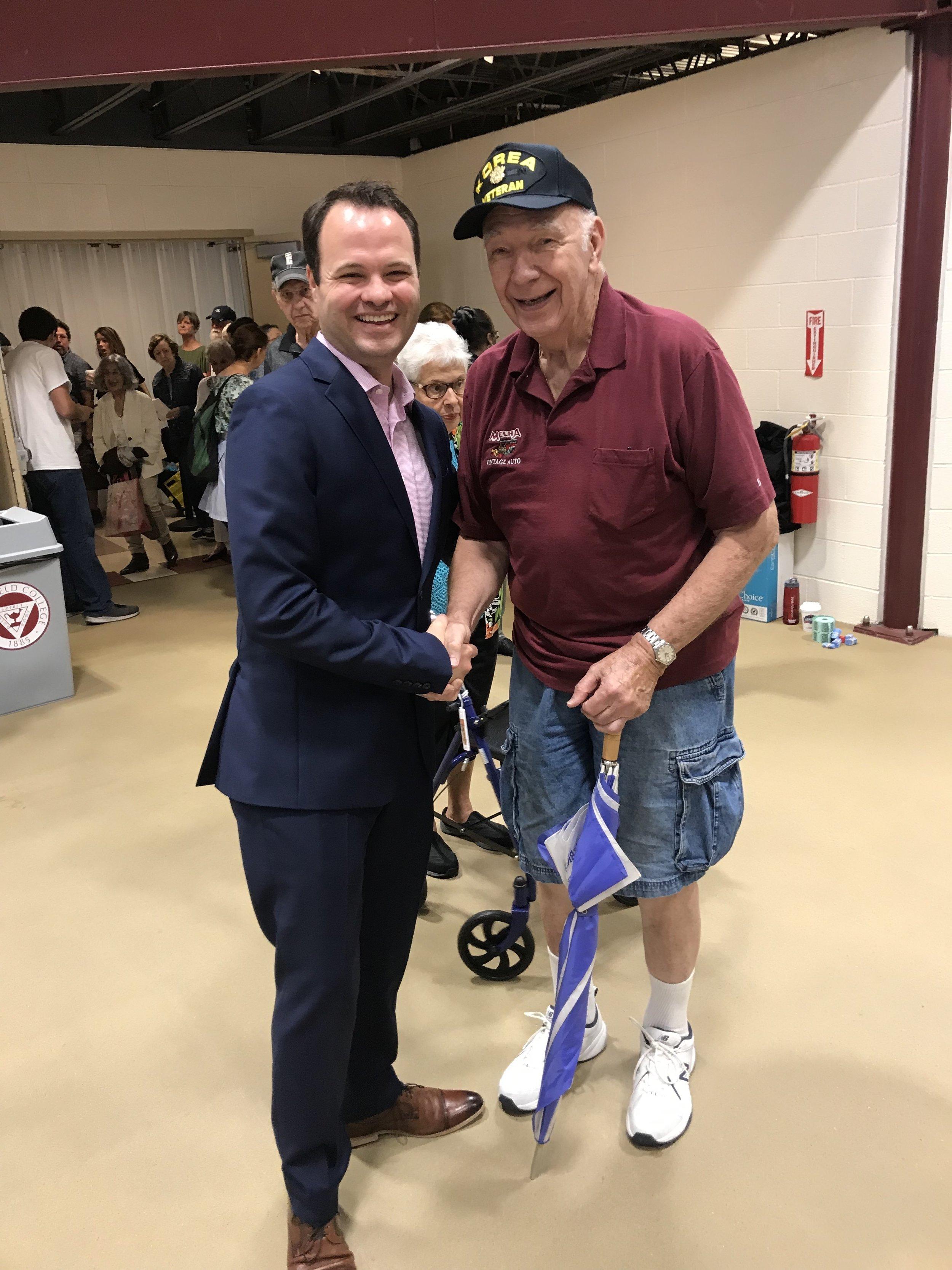 Sen. Eric Lesser greeting people at 2019 Thrive Fair_2.jpg